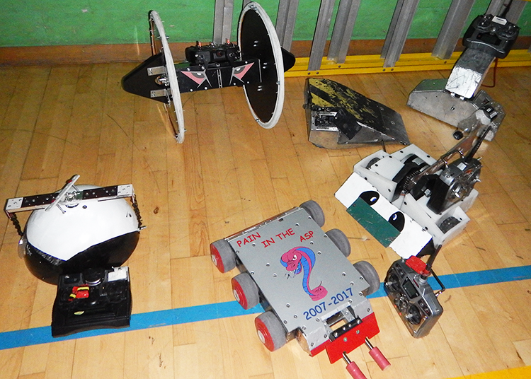 A group of featherweight robots waiting to enter the arena
